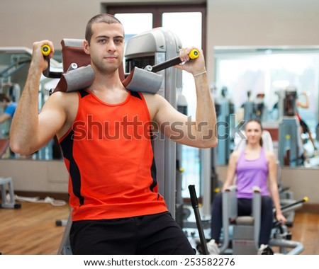 Man doing fitness in a gym - stock photo