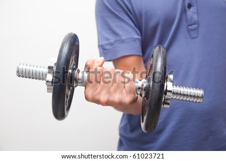 Man doing his training with dumbbells - stock photo