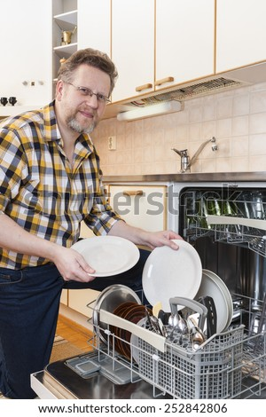 Man doing Household Chores - stock photo