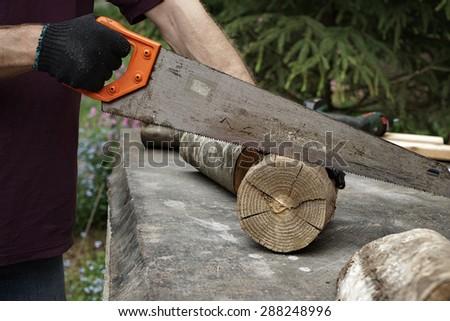 man doing nag of  wood outside - stock photo