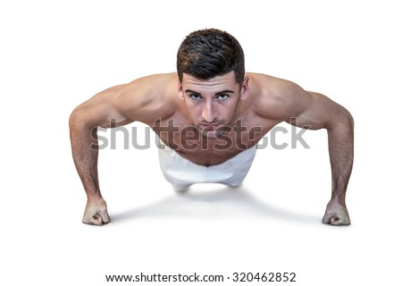 Man doing push up with clenched fist over white background