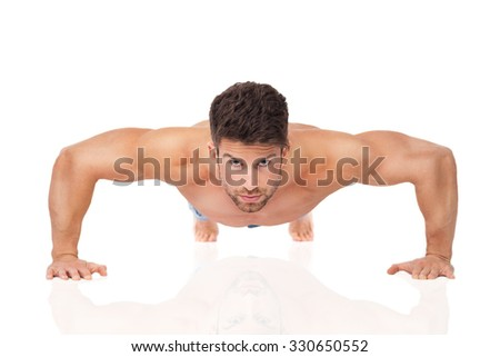 Man doing push-ups  - stock photo