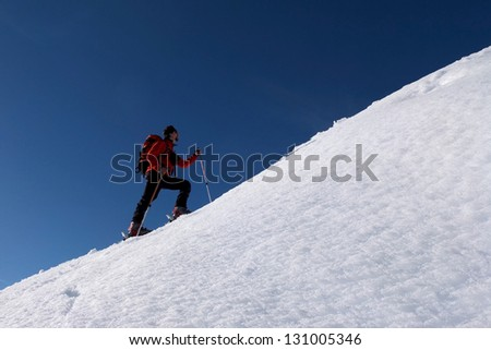 Man doing ski touring and ascending the hill