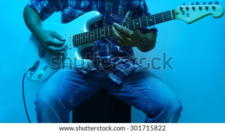 man doing solo on electric guitar - stock photo