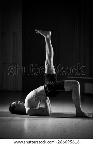 man doing yoga in a sports hall