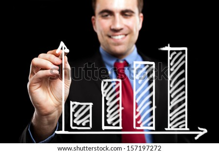 Man drawing a chart on the screen using a chalk - stock photo