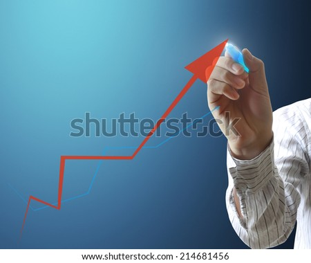 man drawing a graph on a glass wall