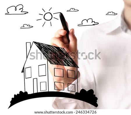 Man drawing a growing real estate chart