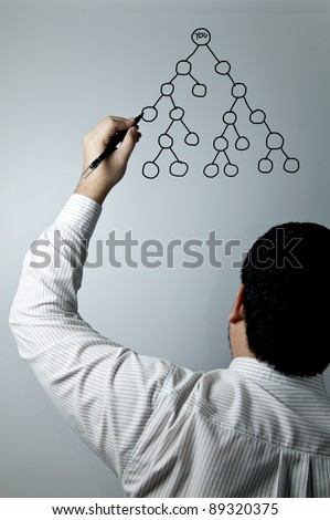 Man drawing a multi level marketing chart - stock photo