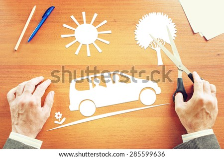 Man dreaming about family journey by car. Abstract conceptual image - stock photo