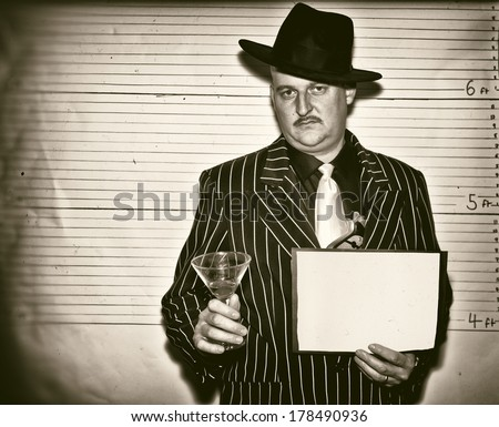 Man dressed as a 1920s ganster in police line up - stock photo