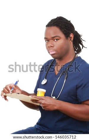 Man dressed in scrubs with medicine - stock photo