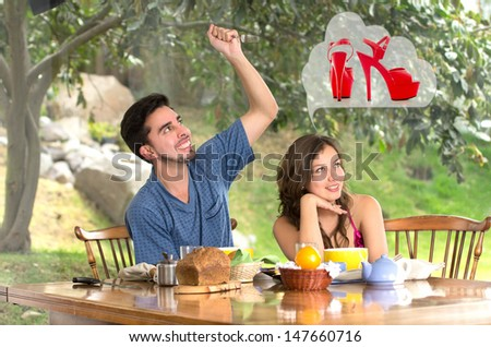 Man drestroying womans dreams about shoes at home - stock photo