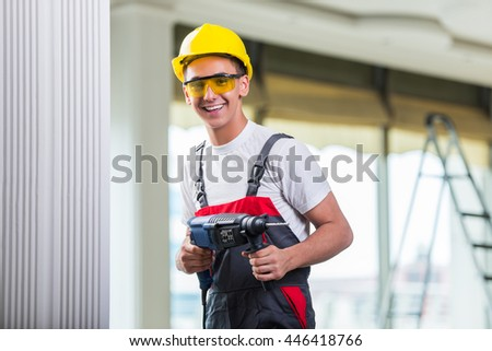 Man drilling the wall with drill perforator - stock photo