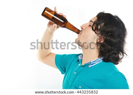 man drink beer from bottle with pleasure isolated on white - stock photo