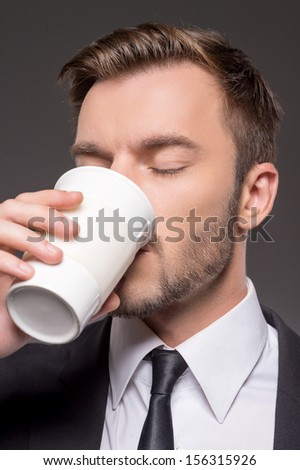 Man drinking coffee. Portrait of confident young men drinking