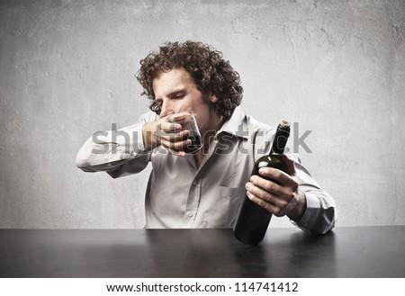 Man drinking some wine - stock photo