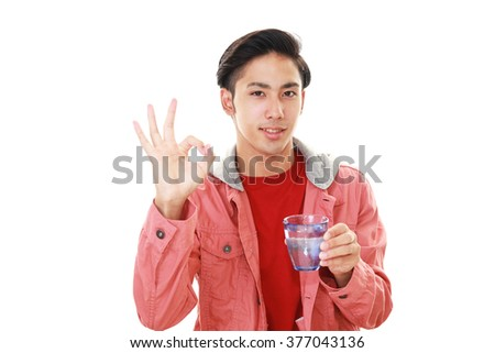 Man drinking water - stock photo