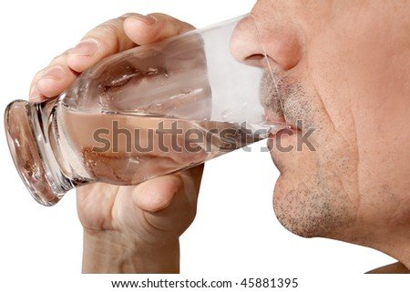 man drinks water from a glass - stock photo