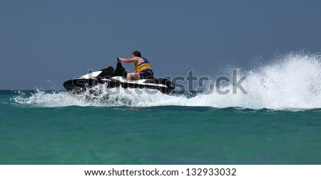 man drive on the jetski - stock photo