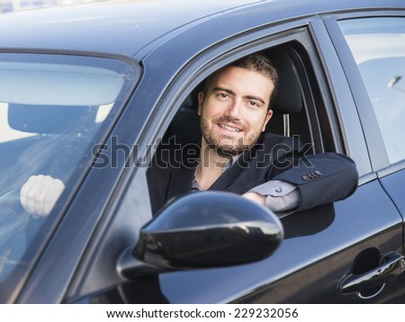 man driving a car - stock photo
