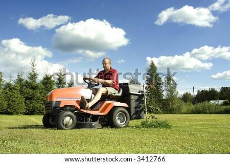 Man driving a lawnmower