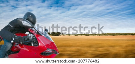 Man driving a motorcycle - stock photo