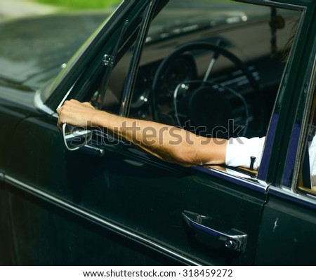 Man driving car and enjoying his ride