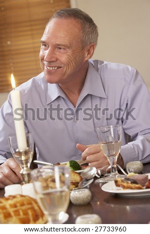Man Eating Dinner At Home