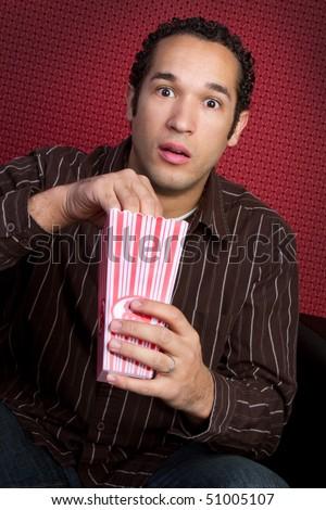 Man Eating Popcorn - stock photo