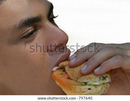 man eating sandwich - stock photo