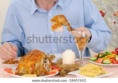 Man eating turkey - stock photo