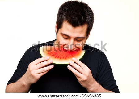 man eating watermelon - stock photo