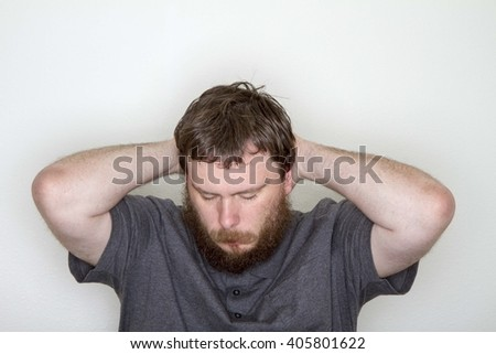 Man either thinking hard, sad, depressed, or relaxing. - stock photo