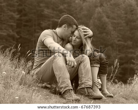 Man embrace woman outdoor, happy couple - stock photo