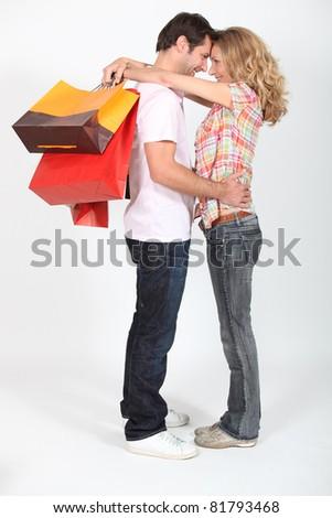 Man embracing his girlfriend - stock photo