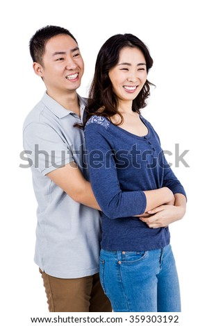 Man embracing woman against white background