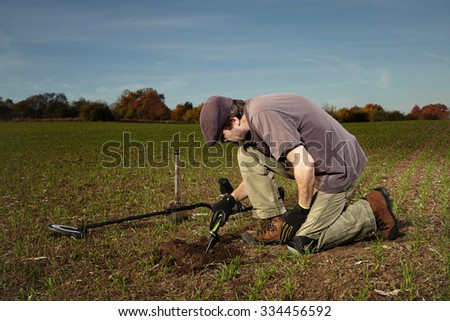 Man enjoying finding of treasures - stock photo