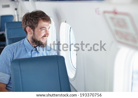 Man enjoying his journey by airplane
