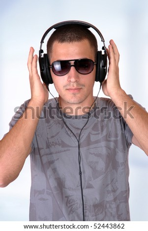 Man Enjoying Music over abstract background