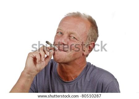 Man enjoying smoking s marijuana joint - stock photo