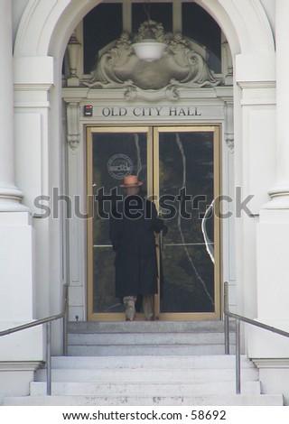 Man entering Old City Hall, Berkeley, California - stock photo