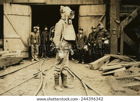 Man equipped with Draeger Oxygen Helmet, about to enter a coal mine in Pennsylvania. January 1911 photo by Lewis Hine. - stock photo