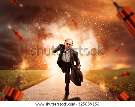 Man escaping from dynamite exploding - stock photo