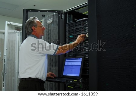 Man examining machine in computer room