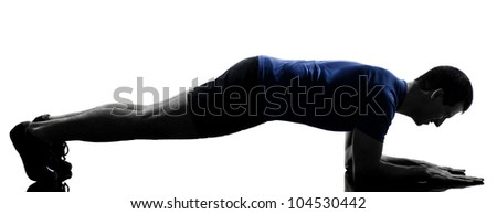 man exercising workout fitness aerobics posture in silhouette studio isolated on white background - stock photo