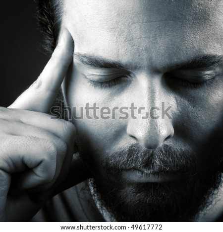 Man expressing headache or think meditation concept - stock photo