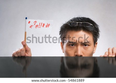Man expressing her angry with flag made of paper and pencil - stock photo