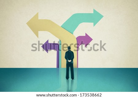 Man Facing  Flat Colored Arrows Pointing towards Different  Directions - stock photo
