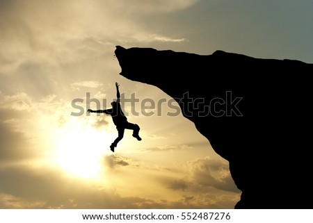 Man falling from the mountain edge. Conceptual scene.